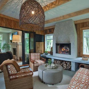 Cette image montre une véranda traditionnelle de taille moyenne avec moquette, un manteau de cheminée en béton, un plafond standard, un sol blanc et une cheminée standard.