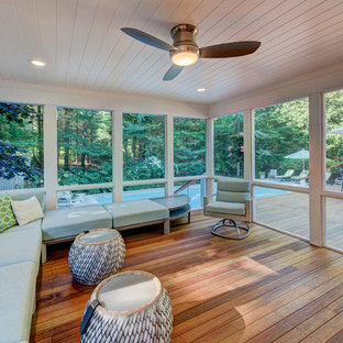 Mid-sized transitional medium tone wood floor sunroom photo in New York with no fireplace and a standard ceiling