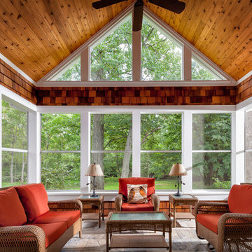 Screen porch features a knotty pine ceiling, cedar shake accents and slate Floor