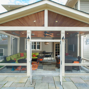 Screened porch with flagstone patio in Bethesda