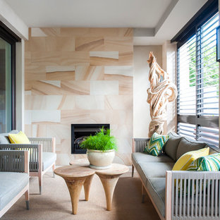 Design ideas for a tropical sunroom in Melbourne with a standard fireplace and a standard ceiling.