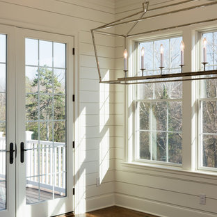Example of a mid-sized farmhouse dark wood floor and brown floor sunroom design in Other with a standard ceiling