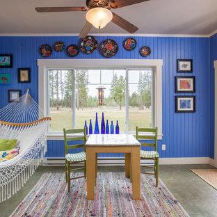 Ispirazione per una veranda boho chic di medie dimensioni con pavimento in cemento, soffitto classico e pavimento grigio