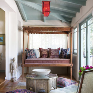 Mediterranean conservatory in Los Angeles with a standard ceiling and terracotta flooring.