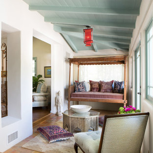 Design ideas for a mediterranean conservatory in Los Angeles with a standard ceiling and terracotta flooring.