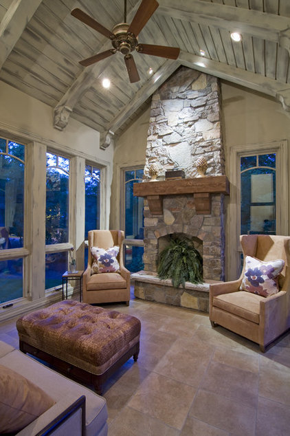 Rustic Sunroom by Schrader & Companies