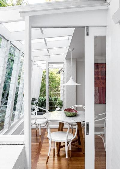 Midcentury Sunroom by Jeffries Studio