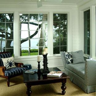 Idée de décoration pour une véranda ethnique de taille moyenne avec moquette et un plafond standard.
