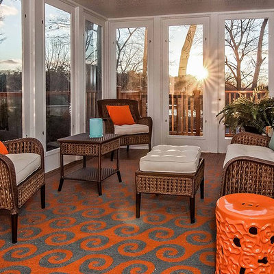 Example of a mid-sized beach style medium tone wood floor and brown floor sunroom design in Boston with no fireplace and a standard ceiling