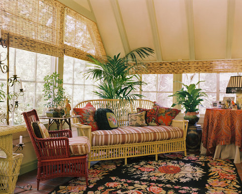 wicker sunroom furniture. example of a classic terracotta floor sunroom design in san francisco with standard wicker furniture