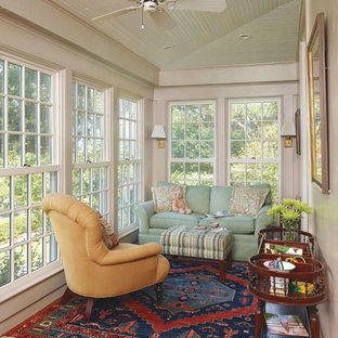Inspiration for a large timeless medium tone wood floor sunroom remodel in Charleston