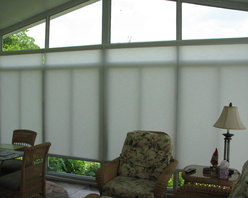 Hunter Douglas - Sun Room Motorized Solar Shades - The East wall was being blasted with early day sun. The clients could not even use their sun room during the time of day that they most wanted to enjoy it. With the shades down, they can now enjoy their sun room in those early morning hours and slowly raise the shades upwards to any point as the sun starts to move Westward. Please note that the $595 price is per shade, and not including installation. Prices vary depending on size of windows.