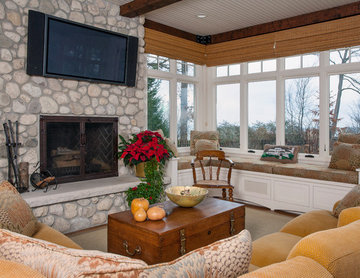 Sun Room with Built In Window Seat, Raised Hearth Stone Fireplace