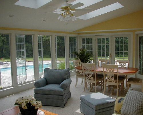 Sunroom design ideas renovations photos with a corner for Sunroom with fireplace designs