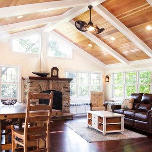 Idéer för stora vintage uterum, med mörkt trägolv, en standard öppen spis, en spiselkrans i sten, tak och brunt golv