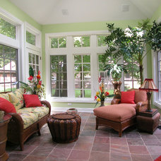 Tropical Porch by Doreen Schweitzer Interiors, Ltd.