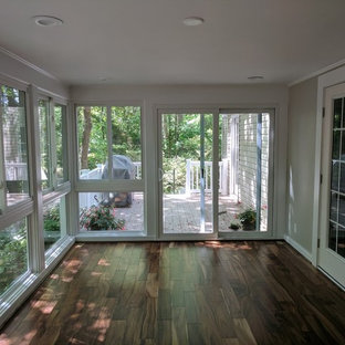Medium sized classic conservatory in Huntington with laminate floors, a standard ceiling and brown floors.