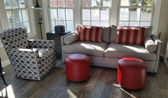 Sunroom in greys with pops of red