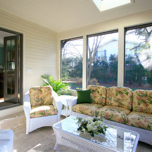Inspiration for a medium sized traditional conservatory in Chicago with porcelain flooring, no fireplace and a skylight.