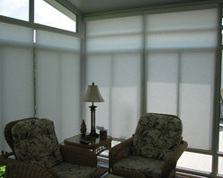 Sunroom Motorized Solar Shades - We chose to cover the two walls where the clients were being bombarded with too much sun. On one side, we intentionally designed the shades to go all the way up to the top of the wall to block the late afternoon sun and heat.