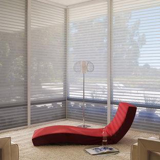 Idee per una grande veranda minimalista con moquette
