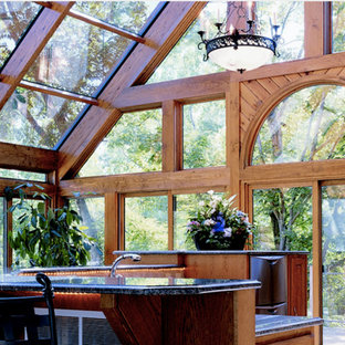 Medium sized contemporary conservatory in Other with light hardwood flooring, no fireplace and a glass ceiling.