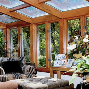 Medium sized contemporary conservatory in Other with light hardwood flooring, no fireplace and a skylight.