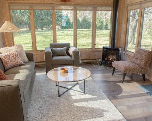 Foto e idee per verande veranda moderna con camino ad angolo for Proiettato in veranda con camino