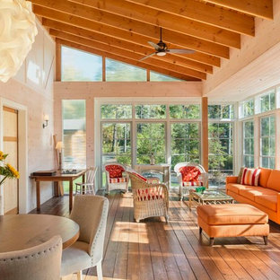 Inspiration for a large rustic medium tone wood floor and brown floor sunroom remodel in Other with no fireplace and a standard ceiling