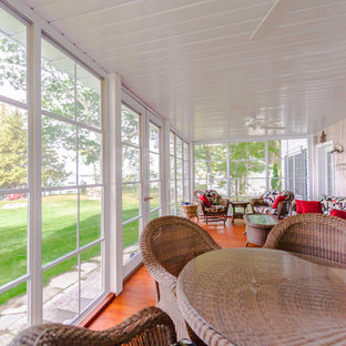 Inspiration for a mid-sized transitional medium tone wood floor and brown floor sunroom remodel in Other with no fireplace and a standard ceiling