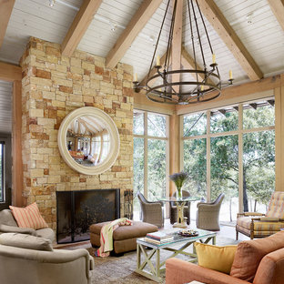 This is an example of a medium sized classic conservatory in Houston with a stone fireplace surround, a standard ceiling and a standard fireplace.