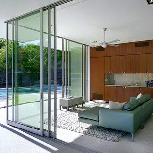 Ispirazione per una veranda moderna di medie dimensioni con pavimento in cemento, nessun camino e soffitto classico