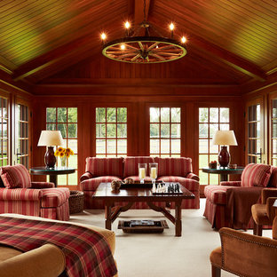 Photo of a large traditional conservatory in Minneapolis with carpet, no fireplace and a standard ceiling.