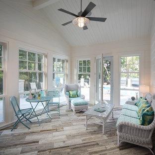 Sunroom - beach style light wood floor and gray floor sunroom idea in Milwaukee with a standard ceiling
