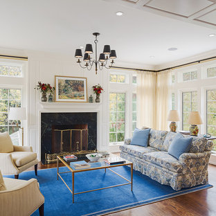 Design ideas for a medium sized traditional conservatory in Philadelphia with medium hardwood flooring, a standard fireplace, a stone fireplace surround and a standard ceiling.