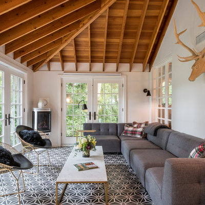 Sunroom - large transitional ceramic tile and multicolored floor sunroom idea in Other with a standard ceiling, a corner fireplace and a metal fireplace