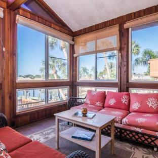 Foto di una veranda moderna con pavimento in terracotta e pavimento multicolore