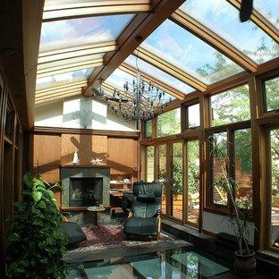 Idee per una veranda moderna con soffitto in vetro