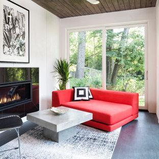 Idées déco pour une petit véranda contemporaine avec sol en stratifié, une cheminée ribbon, un manteau de cheminée en carrelage, un plafond standard et un sol gris.