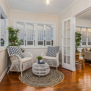 Design ideas for a traditional sunroom in Brisbane with medium hardwood floors, a standard ceiling and brown floor.