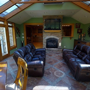 Example of a mid-sized trendy terra-cotta floor sunroom design in Other with a glass ceiling, a standard fireplace and a stone fireplace