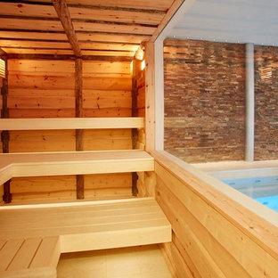 Modelo de piscina contemporánea, interior y rectangular, con adoquines de piedra natural