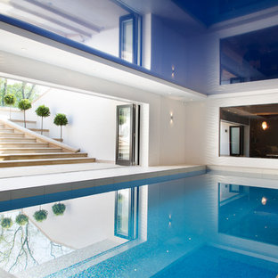 Photo of a large contemporary indoor rectangular swimming pool in Cheshire with tiled flooring.