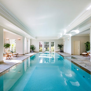 Design ideas for a traditional indoor rectangular swimming pool in Wiltshire.