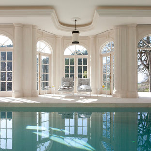 Photo of a medium sized classic indoor rectangular lengths swimming pool in London with a pool house.
