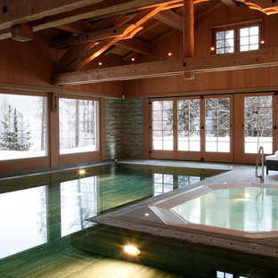 Design ideas for a rustic indoor rectangular swimming pool in London with a hot tub.