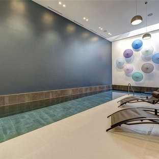 Design ideas for a mid-sized contemporary pool in London.