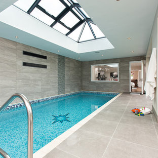 Inspiration for a contemporary indoor tile and rectangular pool house remodel in Berkshire