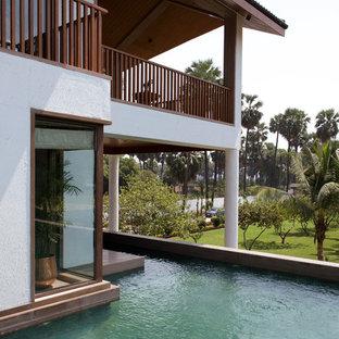 Ejemplo de piscina elevada, de estilo zen, a medida, en patio lateral
