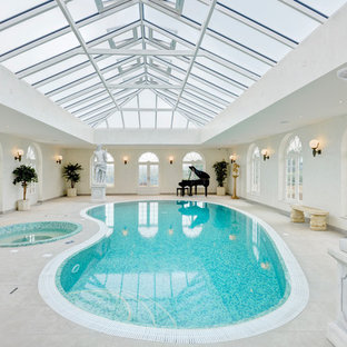 Large traditional indoor kidney-shaped swimming pool in Hertfordshire.